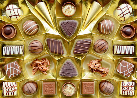 Selection of fine milk and dark chocolate belgian pralines, top view full frame background.