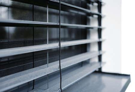 A closeup of a window with external aluminum venetian blinds. 스톡 콘텐츠