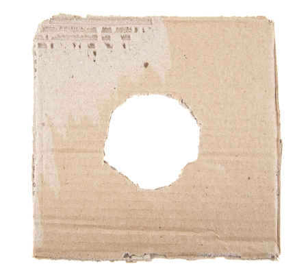 ripped: Ripped hole in cardboard on white background Stock Photo