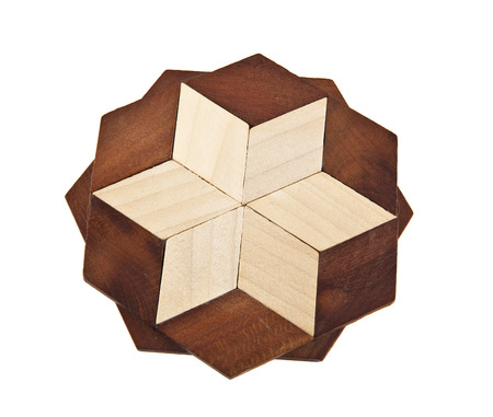 trivet: Wooden trivet on a white background Stock Photo