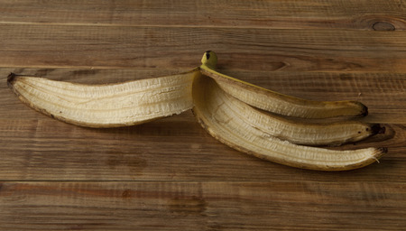 banana skin: skin of banana on a wooden table