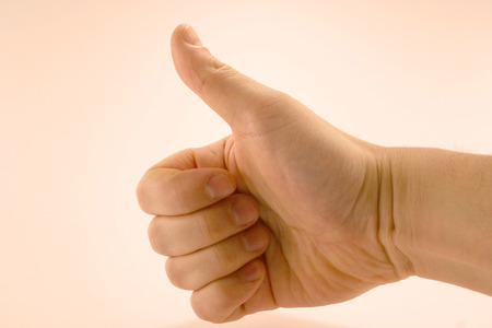 alright: A thumbs up on white background Stock Photo