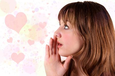 cute teen girl: Isolated cute teen girl whispers hearts  Stock Photo