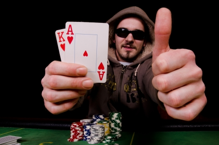 all right: Poker player shows all right  Stock Photo