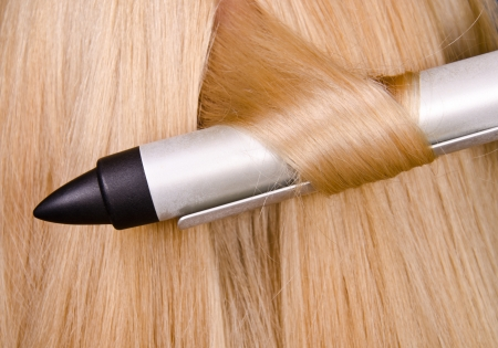 curling irons: Curler and blond hair in the hairdresser saloon   Stock Photo
