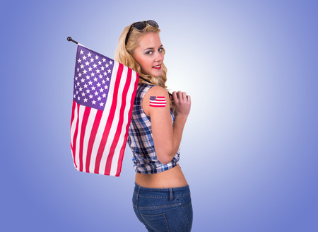 Caucasian woman with american flag tattoo photo