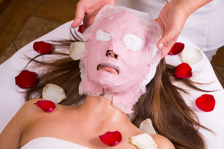 placenta: Beautiful young girl gets a facial mask at beautician  professional Cosmetological care