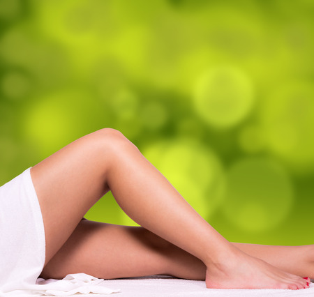hot girl legs: Beautiful legs with green gradient background.