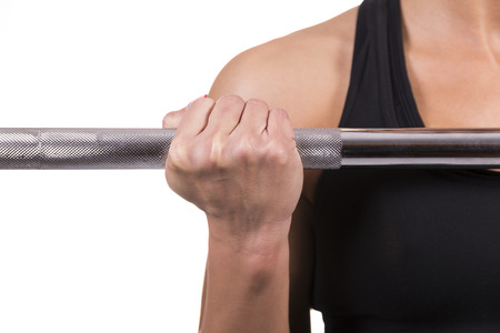 Caucasian Woman lifting weight in a fitness room  photo
