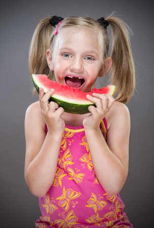 toothless: Little toothless girl eating  watermelon.