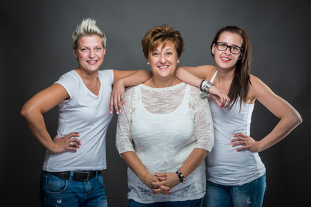 Happy family with mothr and daughters. Studio shot. Standard-Bild