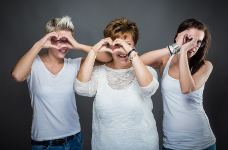 group of hands: Happy family with mothr and daughters. Studio shot. Stock Photo