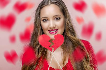 heart broken: Pretty woman holdig broken heart in Valentines Day.