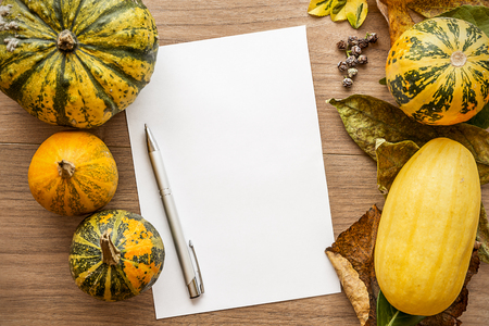 Autumn, Halloween background with leaves and pumpkins. Holiday concept with copy space. Фото со стока