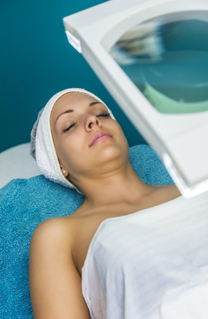 Caucasian woman relaxing in a spa bed and enjoying the treatment.