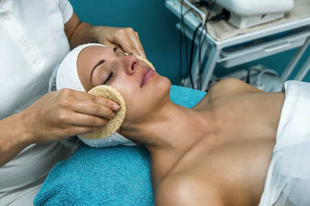 Beautiful woman having cosmetic treatment at beauty salon.