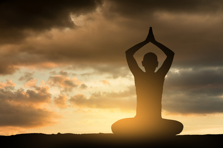 Girl doing yoga excercise at sunset. Silhouette series.