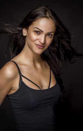 Portrait of beautiful female model on black background. Standard-Bild
