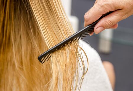 Hair Care. Closeup Of Beautiful Girl After Bath Hairbrushing Healthy Straight Brown Hair.