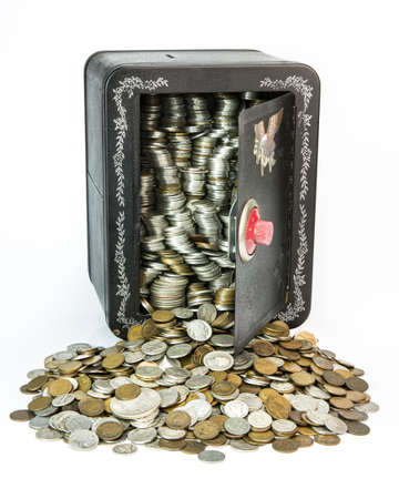 pennies: A childs savings back pack full of old coins  A life savings of old coins spill from the open vault   Old US coins including silver dollars, wheat back pennies, Indianhead pennies, buffalo nickels, mercury dimes and silver quarters  Stock Photo