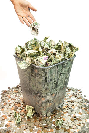 garbage can: Bad purchases, band invesments, bad loans, it all amounts to throwing away your money  Stock Photo