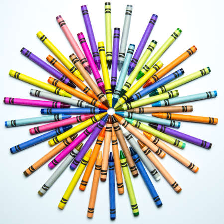 configured: A colorful array of crayons configured into a round sunburst   What child did not spend hundreds of hours playing with crayons and drawing pictures for their parents