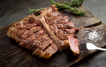porterhouse steak is grilled sliced on a piece of wood Board. rustic style, top view Stock Photo