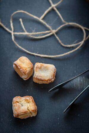 home-made amarettini cookies on a dark background, top view Archivio Fotografico