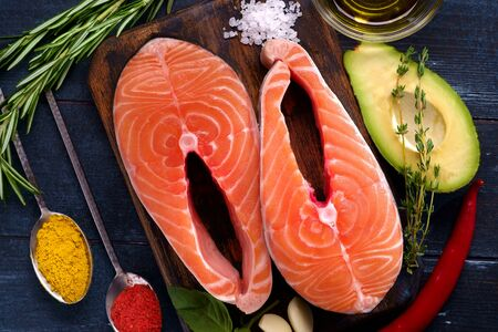 Preparation for cooking salmon Steaks fish with seasonings and herbs. Healthy diet, top view Reklamní fotografie