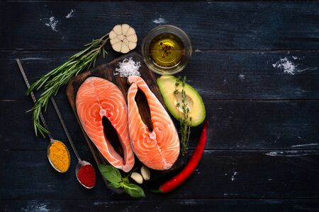 Preparation for cooking salmon Steaks fish with seasonings and herbs. Healthy diet, top view and copy space