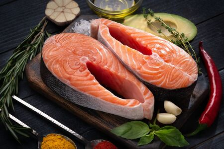 Preparation for cooking two ideal salmon Steaks fish with seasonings and herbs. Healthy proper diet