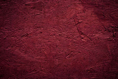 Red painted wood panels made of sawdust and shavings. OSB texture Imagens