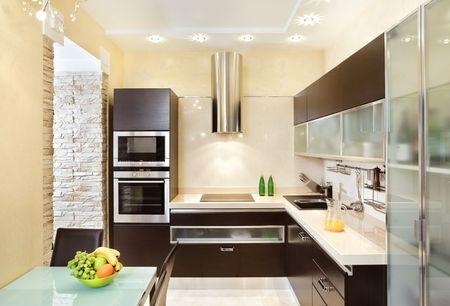 warm colors: Interior de cocina moderno en tonos c�lidos  Foto de archivo