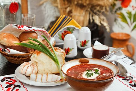 Ukrainian borsch, red-beet soup with pampushki, lard and garlic photo