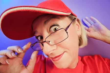 Funny surprised woman portrait on vivid color background