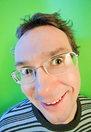 Funny surprised man in glasses portrait on vivid color background Stock Photo - 7259658