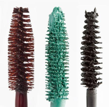 glitter gloss: color mascara Brushes isolated on white macro