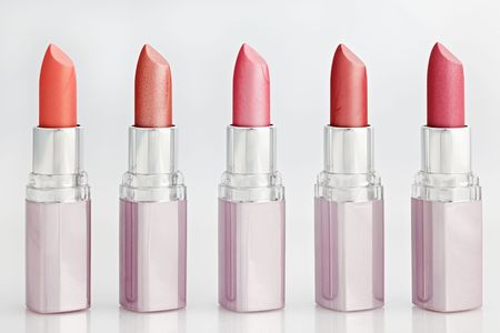 Color lipsticks arranged in line isolated on white photo