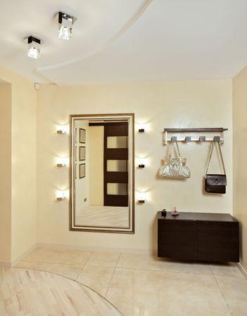 anteroom: Hall in beige tones with hallstand and golden mirror