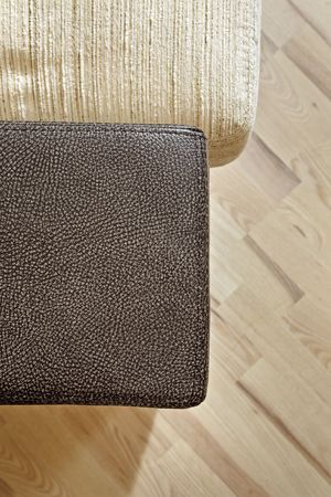 Details of leather sofa headboard on Wooden floor Stock Photo - 7262474