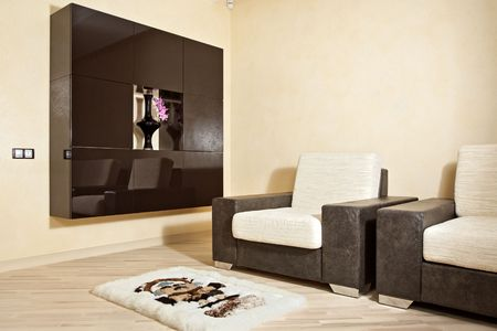 Part of interior with armchair, carpet and niche Stock Photo