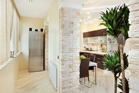 Modern Kitchen and Balcony interior in warm tones Stock Photo - 7262276