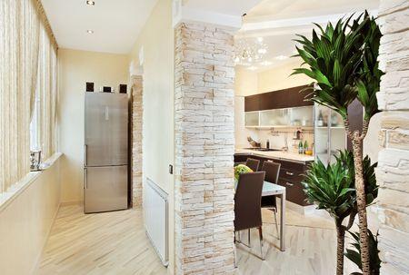 Modern Kitchen and Balcony interior in warm tones photo