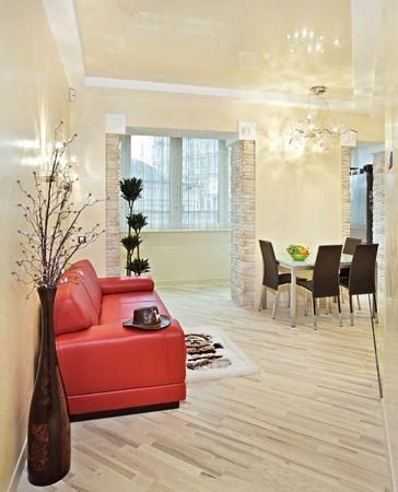 Modern studio interior in warm tones with red sofa Stock Photo - 7262255