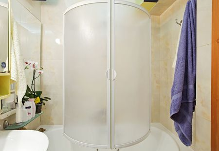shower cubicle: Modern small shower-bath with blue towel