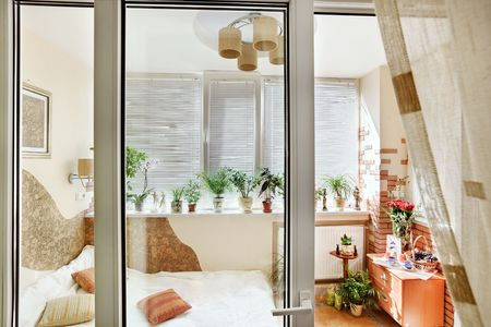 Sunny bedroom interior view through the balcony door Stock Photo - 7262768