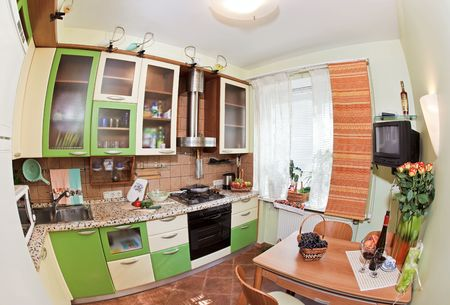 Green Kitchen interior with many utensils and window, fisheye View photo