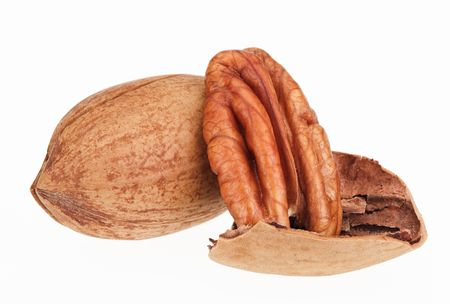 nutshells: Few pecan nuts isolated on white, one cracked