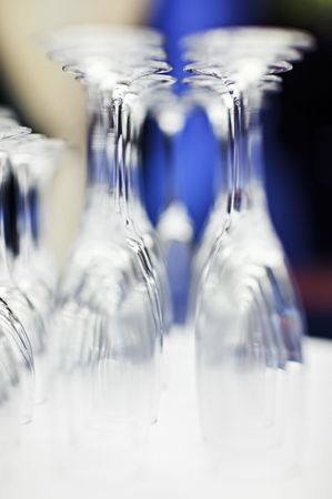 upturned: Upturned set of wine glasses on blurred blue background with extremely shallow depth of field Stock Photo