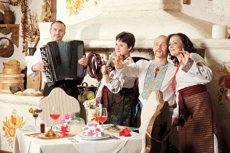 Ukrainian ethnic music band concert in traditional restaurant interior photo